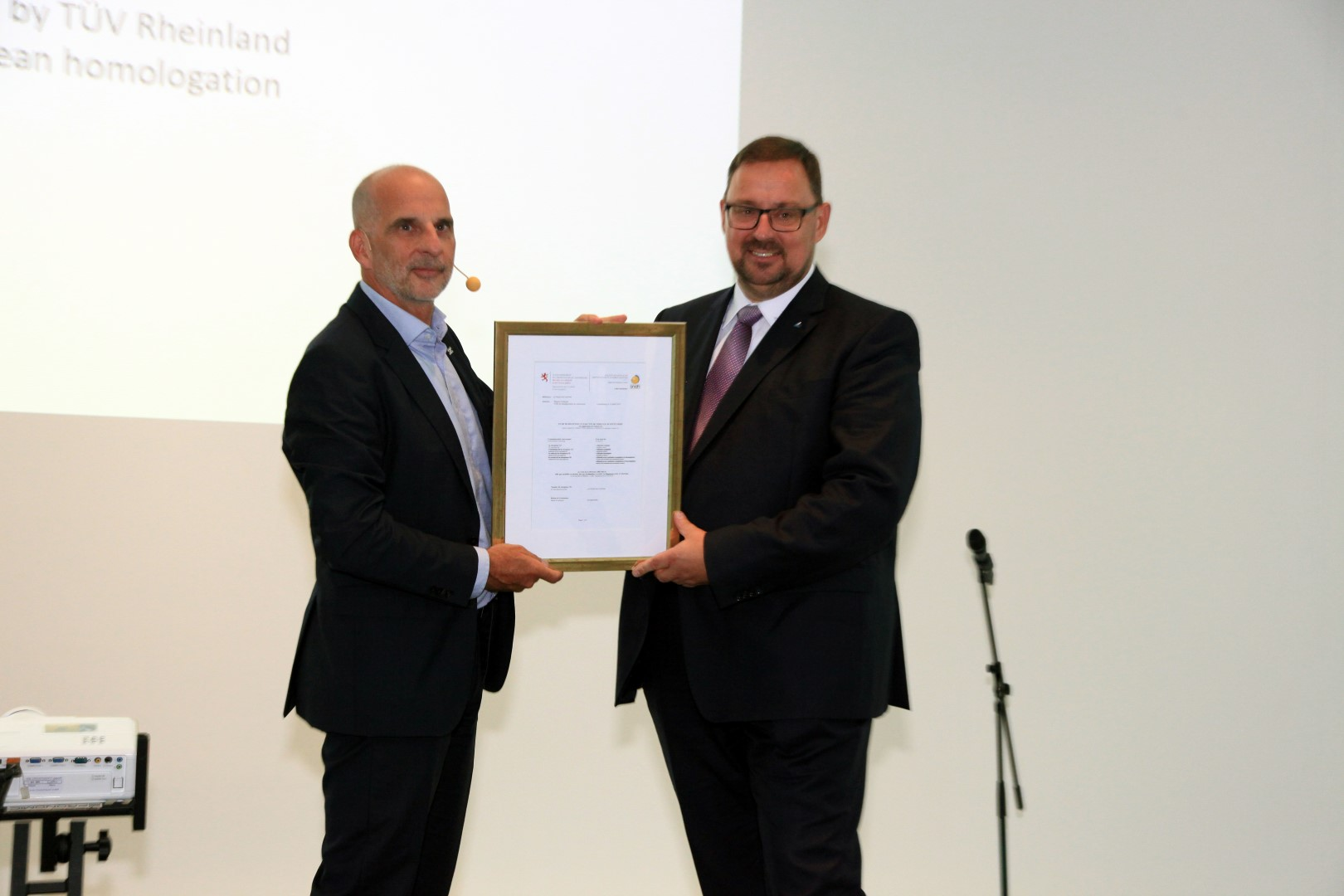 Alex Klose, AIWAYS Executive Vice President for Overseas Operations, received the AIWAYS U5 EU WVTA certificate from Gunnar Pflug, Western  (Large)